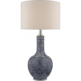 CYAN exotic table lamp with intricate blue swirling patterned base and ivory shade