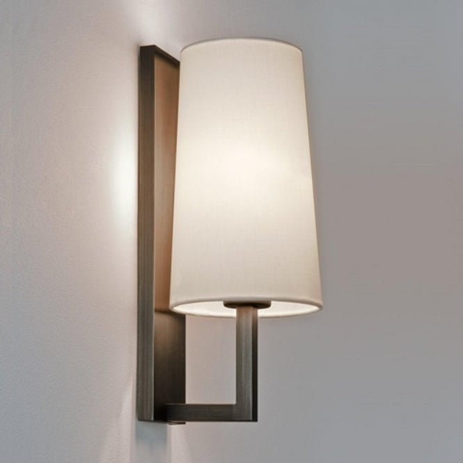 Modern bronze wall light for lighting in bedrooms and bathrooms ip44 riva modern hotel style bronze wall light with white shade aloadofball Gallery
