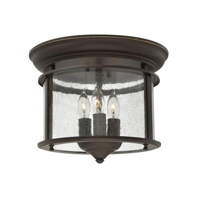 Traditional flush fitting bronze hall lantern with clear seeded glass gentry flush mounted hall ceiling light old bronze aloadofball Image collections