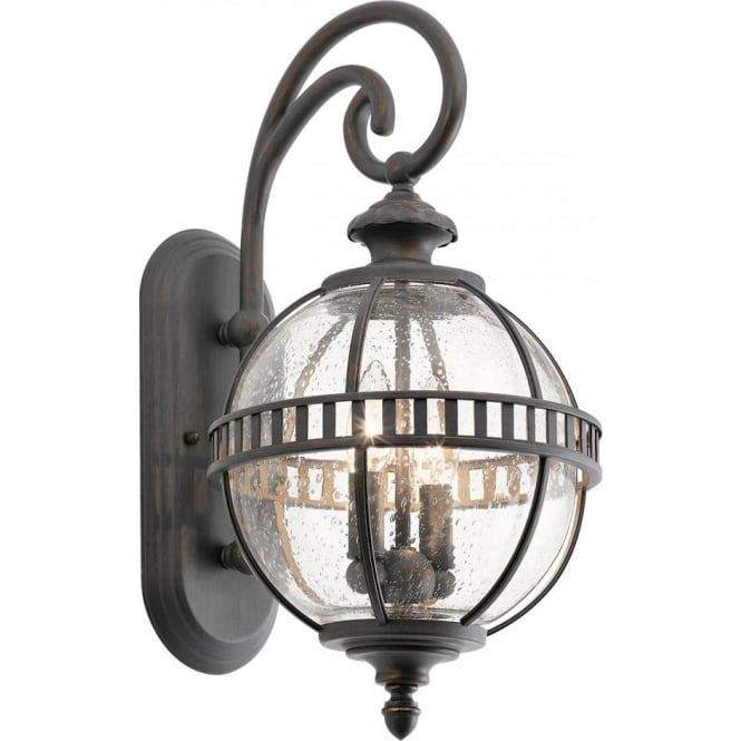glass globe outdoor wall light with bronze detaling in victorian style